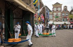 Carriers walking with many cheeses in the famous Dutch cheese market in Alkmaar, Royalty Free Stock Photos