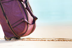 Carries luggage at sandy beach Stock Photography