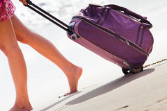 Carries luggage at sandy beach Royalty Free Stock Photo