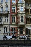 Antique Carrigae with horses in Karlovy Vary. Carrigae with horses is something common on the Downtown of Karlovy Vary an ancient touristic site of Czech royalty free stock images
