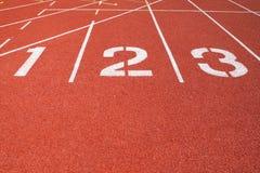 Carril de la pista del atletismo imagen de archivo libre de regalías