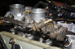Carril del combustible de los coches foto de archivo