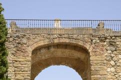 Carril del hierro en el arco de piedra Imágenes de archivo libres de regalías