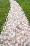 Carril que camina de la teja coloreada Foto de archivo
