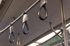 Carriles de mano en un tren Imagen de archivo libre de regalías