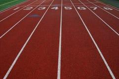 Carriles en pista atlética Imágenes de archivo libres de regalías
