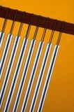 Carrilhões do vento ou da barra no vermelho Fotografia de Stock