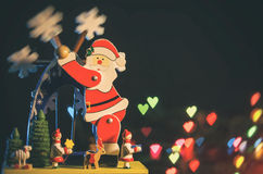 Carrillon of Santa Claus. Carrillon Santa Claus who travels the windmill black background with colored lights and little heart-shaped Stock Image