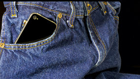 Carring a cell phone in a pair of jeans Royalty Free Stock Photos