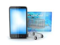 Carrinho de compras, cartão de crédito e telemóvel Fotografia de Stock Royalty Free