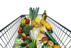 Carrinho de compras com alimento imagens de stock royalty free