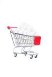 Carrinho de compras com cubos do açúcar imagem de stock