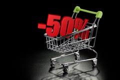 Carrinho de compras com porcentagem de 50% Fotografia de Stock Royalty Free
