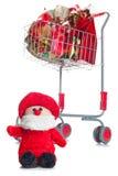 Carrinho de compras com presentes do Natal Imagem de Stock