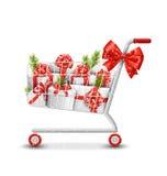 Carrinho de compras da venda do inverno do Natal com caixas de presente brancas e pi Imagens de Stock