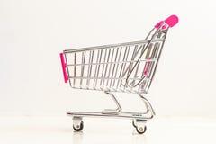 Carrinho de compras diminuto enchido Fotografia de Stock Royalty Free