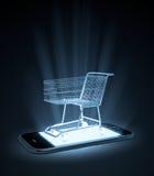 Carrinho de compras em um telefone esperto Fotos de Stock Royalty Free