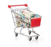 Carrinho de compras enchido com as cápsulas Fotografia de Stock Royalty Free