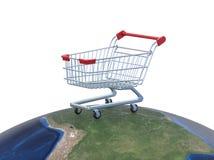 Carrinho de compras sobre o mundo, conceito do mercado global Imagens de Stock