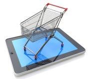 Carrinho de compras sobre um PC da tabuleta no fundo branco Imagem de Stock Royalty Free