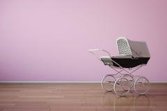 Carrinho de criança de bebê na parede cor-de-rosa Fotografia de Stock Royalty Free