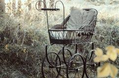 Carrinho de criança de bebê retro fotografia de stock royalty free