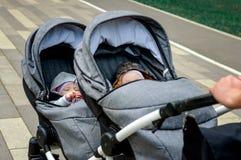 Carrinho de criança gêmeo imagens de stock royalty free