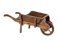 Carrinho de mão de roda de madeira velho da mão pintado e feito à mão Fotografia de Stock Royalty Free