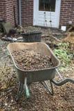 Carrinho de mão no jardim Fotografia de Stock Royalty Free