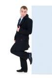 Carrinho de sorriso do homem de negócios perto do espaço em branco vazio Imagem de Stock