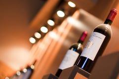 Carrinho do vinho com frascos Foto de Stock Royalty Free