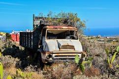 Carro abandonado oxidado Fotografía de archivo libre de regalías