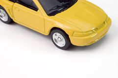 Carro amarelo da economia do brinquedo Fotografia de Stock Royalty Free
