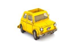 Carro amarelo do brinquedo fotografia de stock