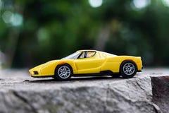 Carro amarelo do brinquedo Foto de Stock Royalty Free