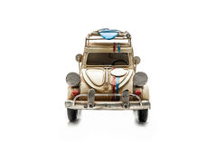 Carro antigo do brinquedo isolado no fundo branco Fotografia de Stock