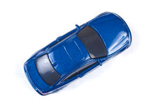 Carro azul diminuto do brinquedo no fundo branco Fotografia de Stock Royalty Free