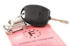 Carro chave com pouco anel chave na forma do carro Fotografia de Stock Royalty Free