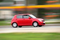 Carro compacto vermelho pequeno Imagens de Stock