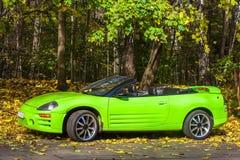 Carro contra as árvores do outono Foto de Stock Royalty Free