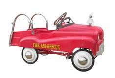 Carro de bombeiros do pedal da criança isolado fotografia de stock
