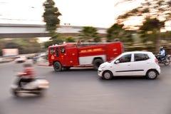 Carro de bombeiros no movimento Imagem de Stock Royalty Free