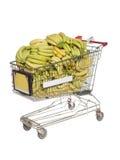 Carro de compra com bananas Fotografia de Stock Royalty Free