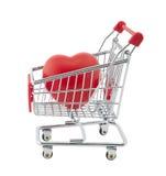 Carro de compra e coração vermelho. O trajeto de grampeamento inclui Fotografia de Stock Royalty Free