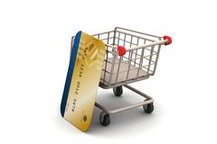 Carro de compras con de la tarjeta de crédito Foto de archivo libre de regalías