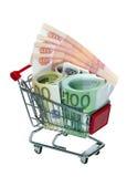 Carro de compras con el dinero Imagenes de archivo