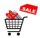 Carro de compras con el presente y la escritura de la etiqueta de la venta Foto de archivo