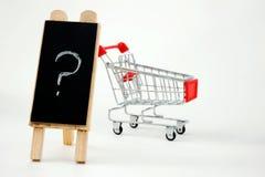 Carro de compras con la pregunta Fotografía de archivo libre de regalías