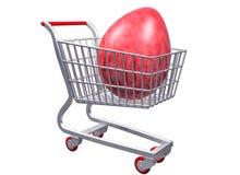 Carro de compras estilizado con el huevo gigante Fotos de archivo