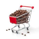 Carro de compras llenado de los granos de café Imágenes de archivo libres de regalías